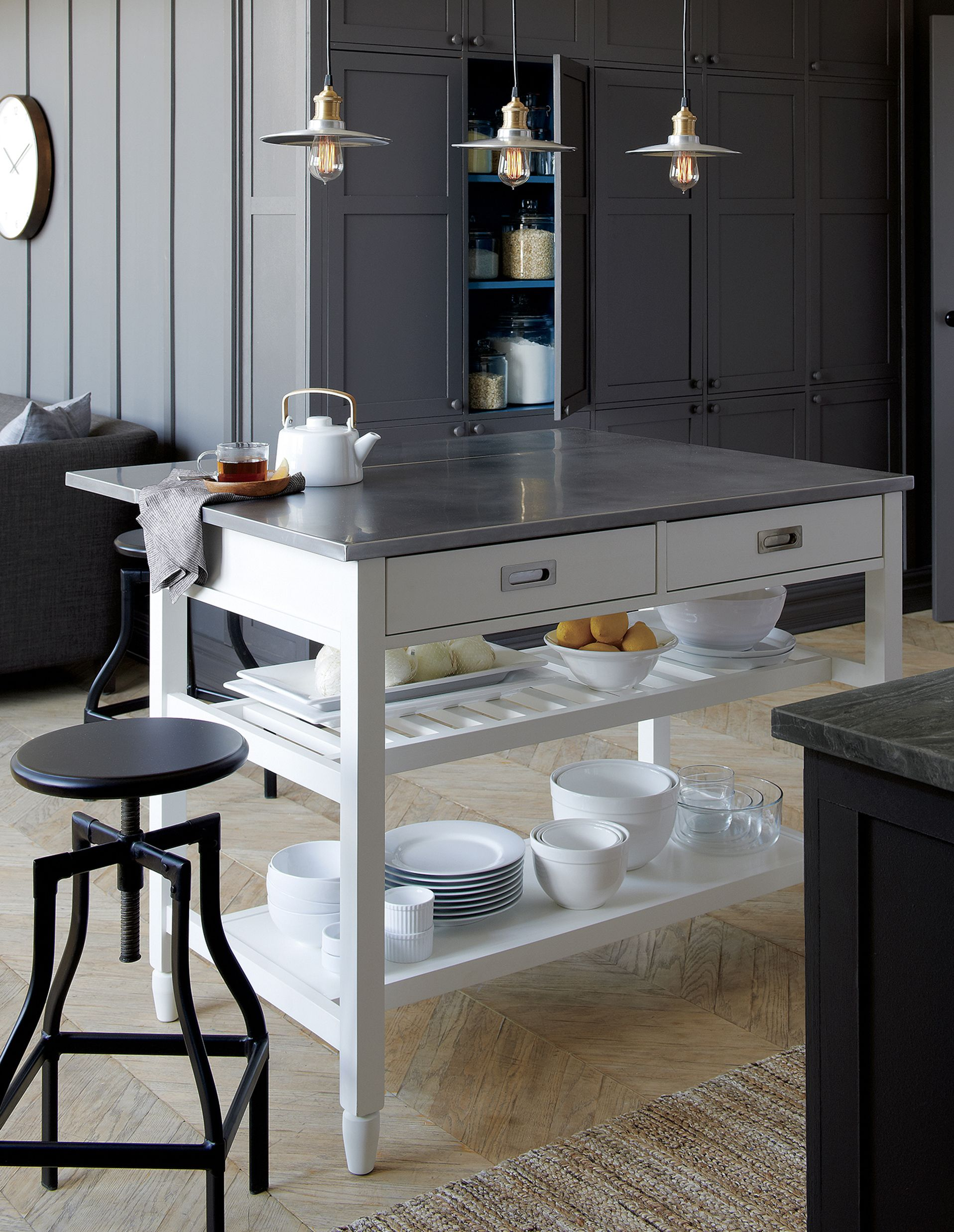 Instantly expand your kitchen's work surface and storage with form, function and versatility. Designed by Bill Eastburn, the Sheridan kitchen island's stainless-steel top is a dream—durable and easy to clean—and rests on a solid base atop casters, making it easy to move when needed.