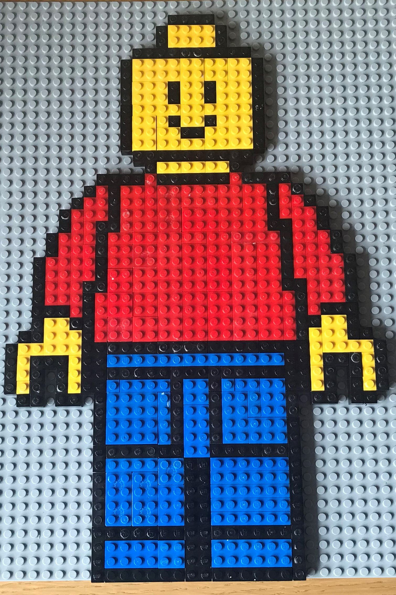 This is a Lego Minifigure Mosaic which I created The design is based of a