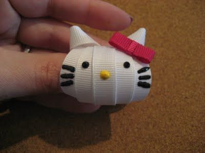 Adorable Hello Kitty hair bow - find that tutorial at http://heckfridays.blogspot.com/2011/05/sculpted-ribbon-hello-kitty-bows.html
