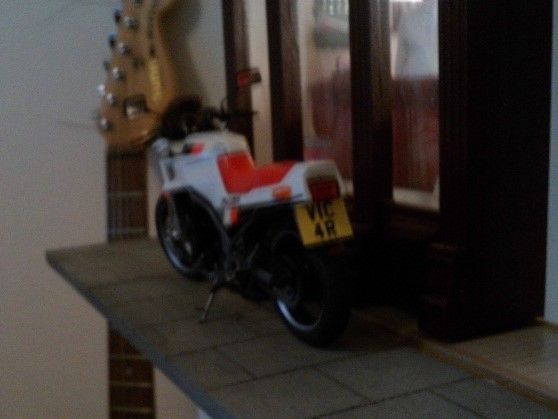 Just finished a motorbike kit which I made a custom number plate for. (Sorry about the guitar in the background.)