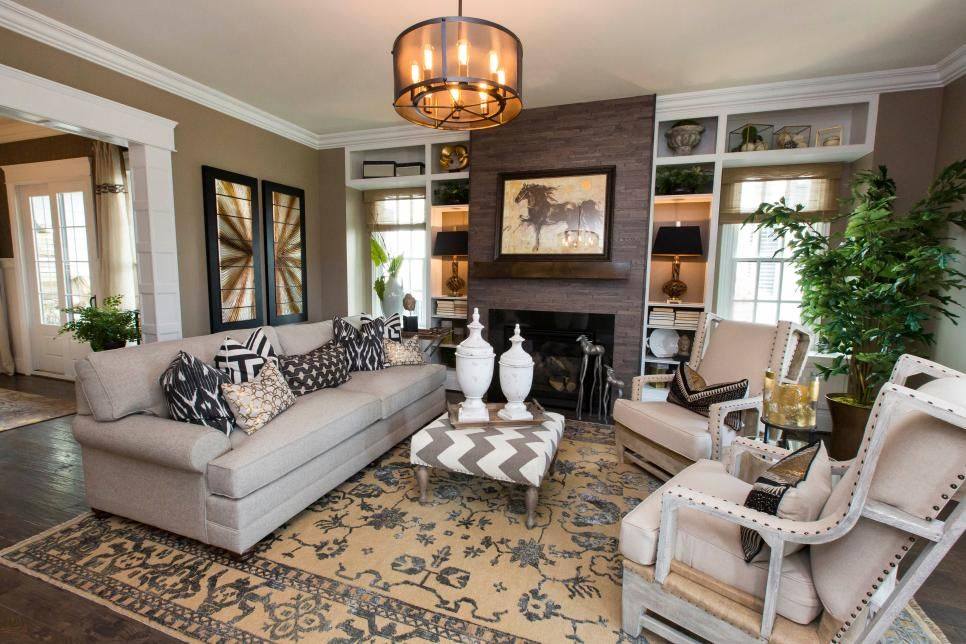 Living spaces · soft neutrals and warm browns fill this comfortable tasteful great room a fireplace serves