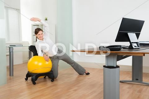 Young Happy Businesswoman Doing Fitness Exercise On Yellow Pilates Ball In Of Stock Photos #AD ,#Fit...
