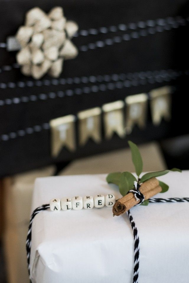 Wrapped gift with letter beads instead of gift tag