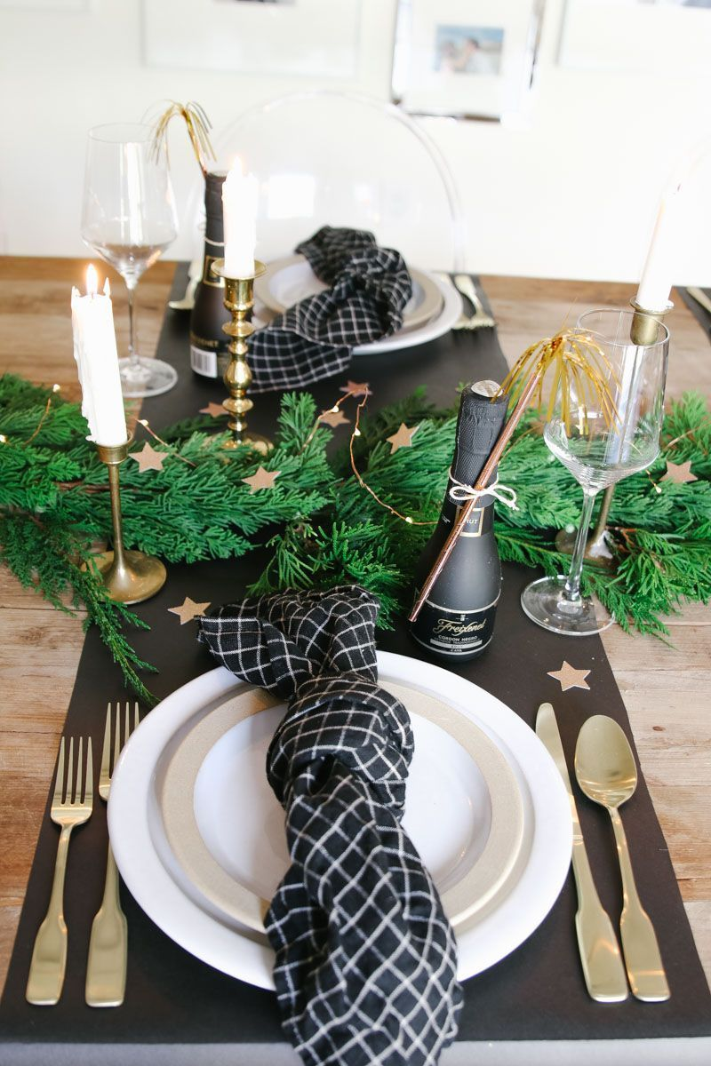 New Year's Eve tablescape in black and gold. Create a