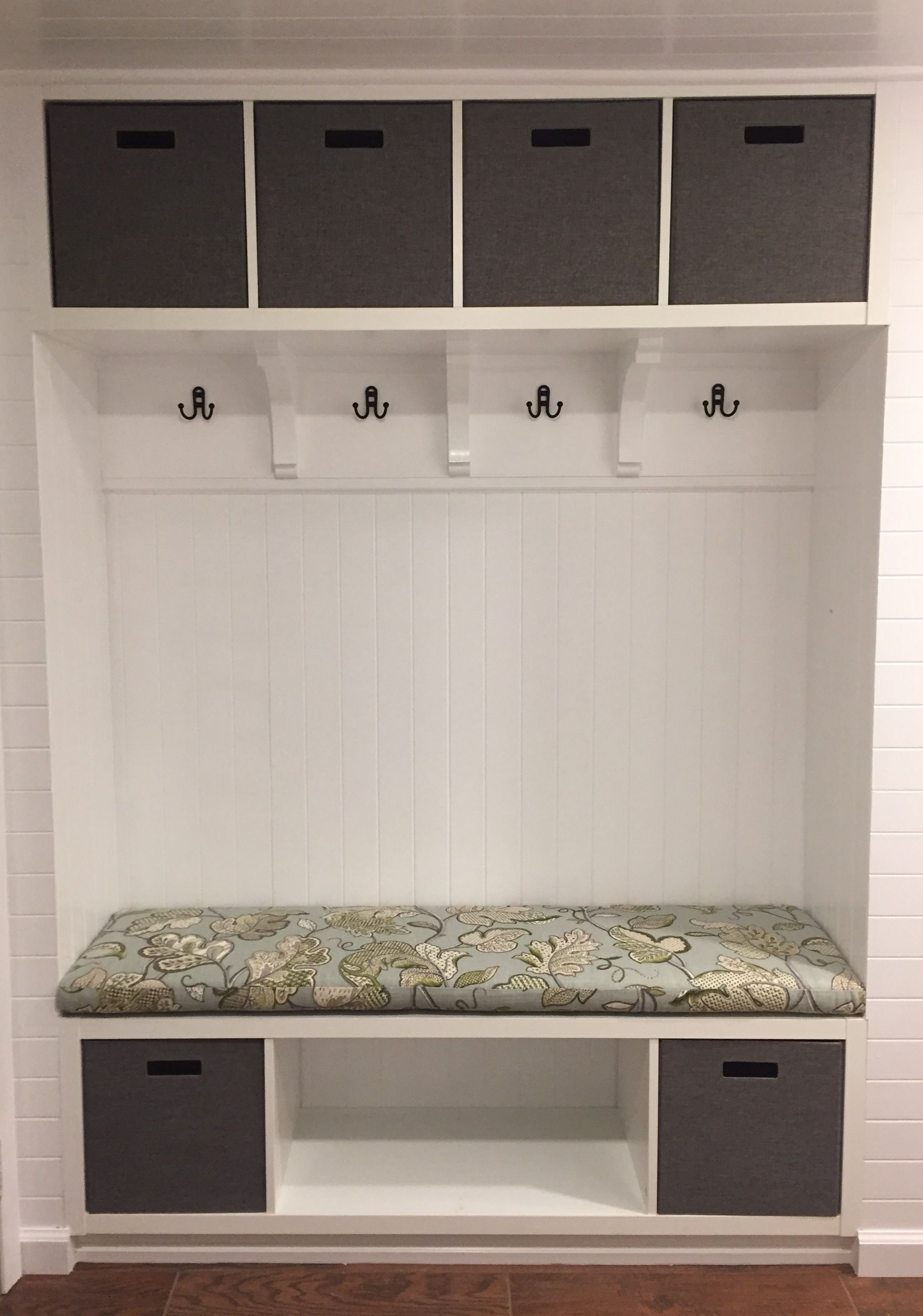 our ikea hack mudroom bench. we used two kallax shelves, paneling