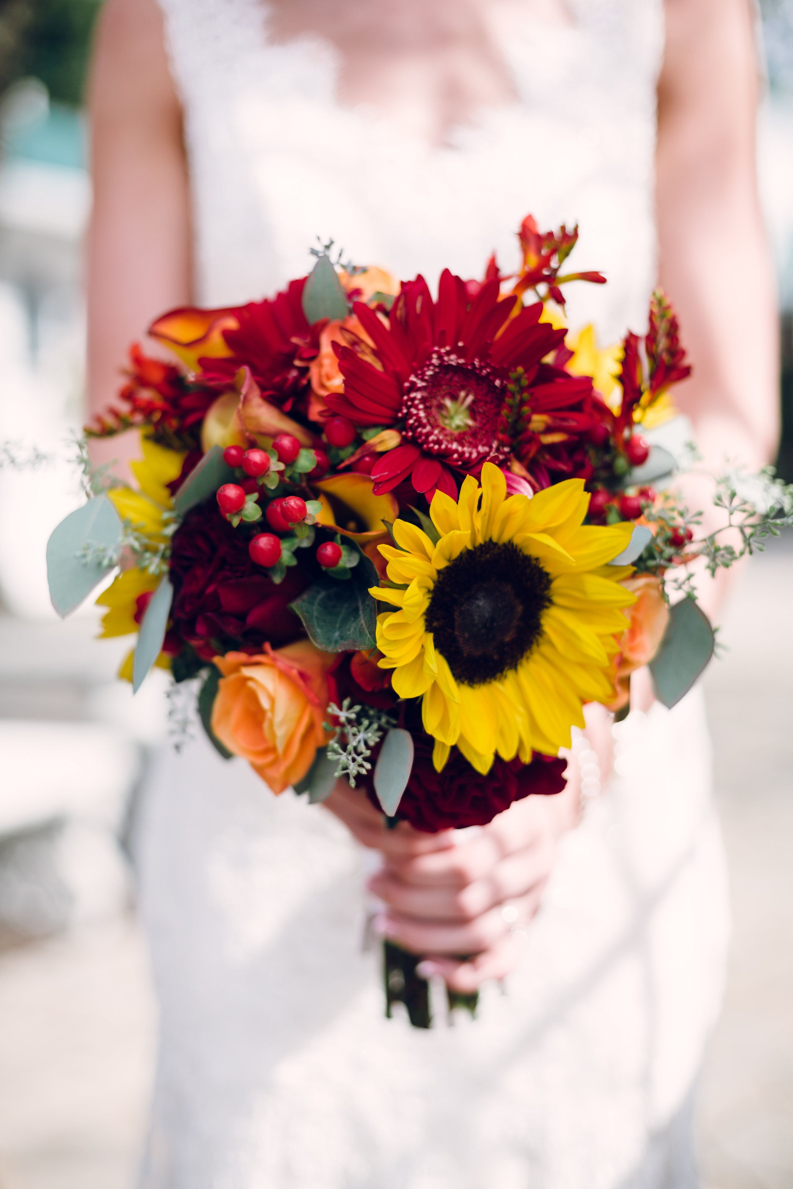 Bridal bouquet with sunflowers and red gerbera daisies
