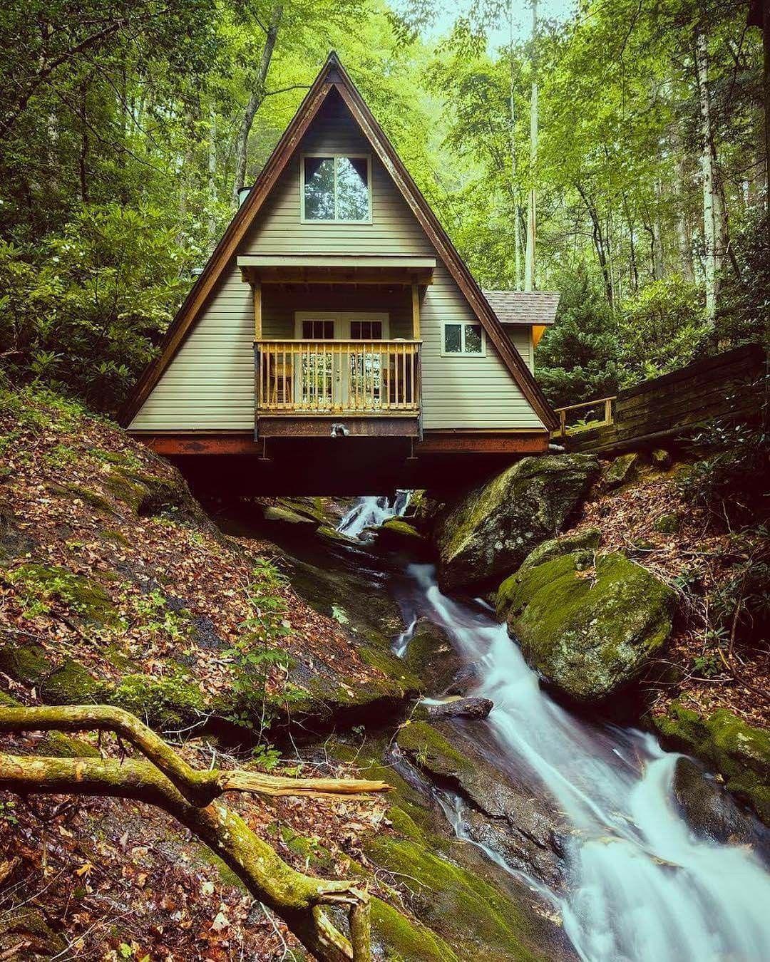 A Frame Cabin Built Over A Creek In Asheville North Carolina A
