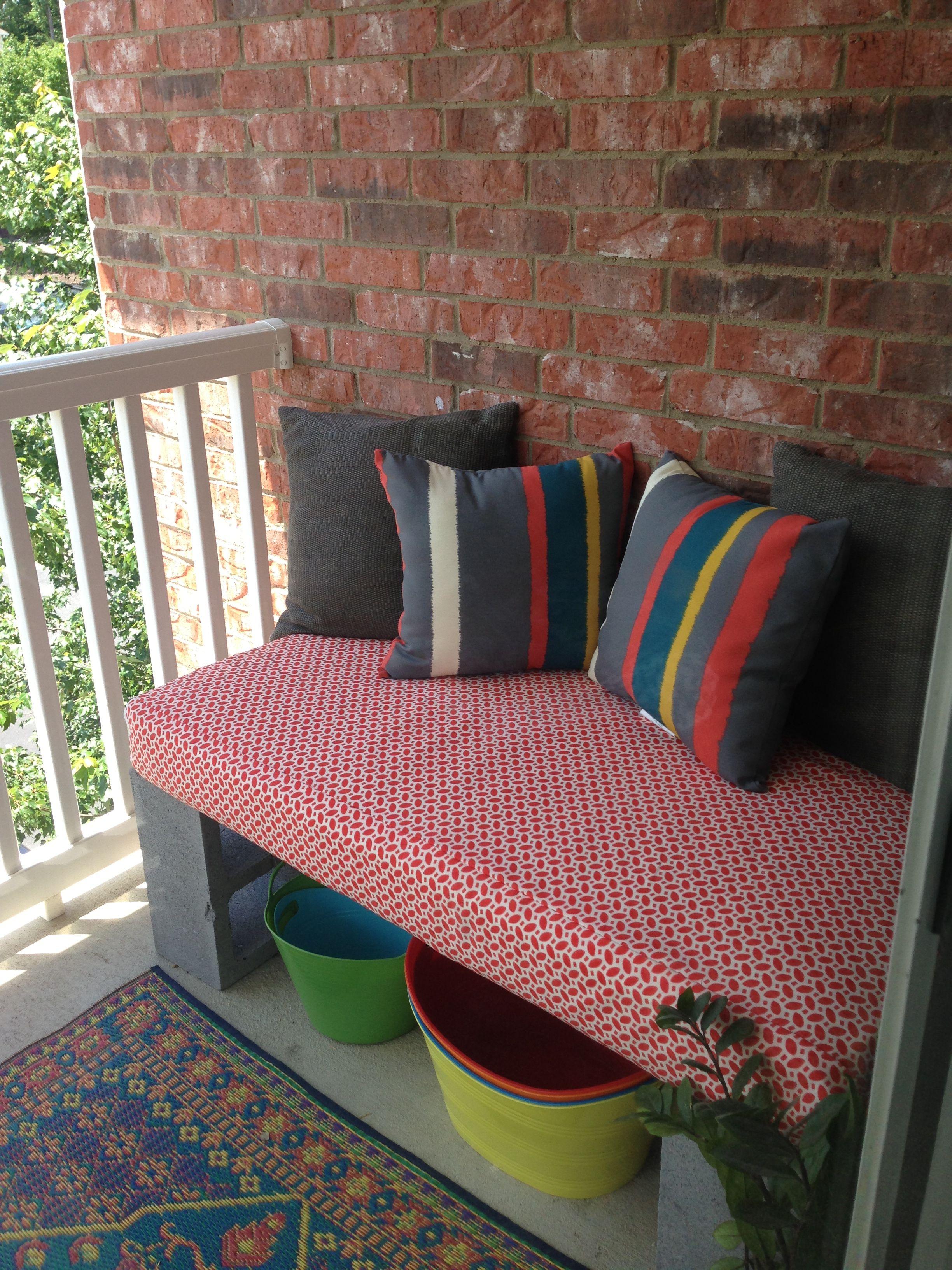 Cinder block bench made from crib mattress.. use a shower