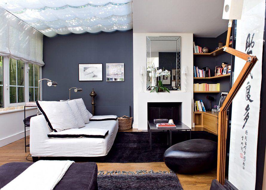 Un salon avec cheminée moderne et graphique Salon gris, Salons and