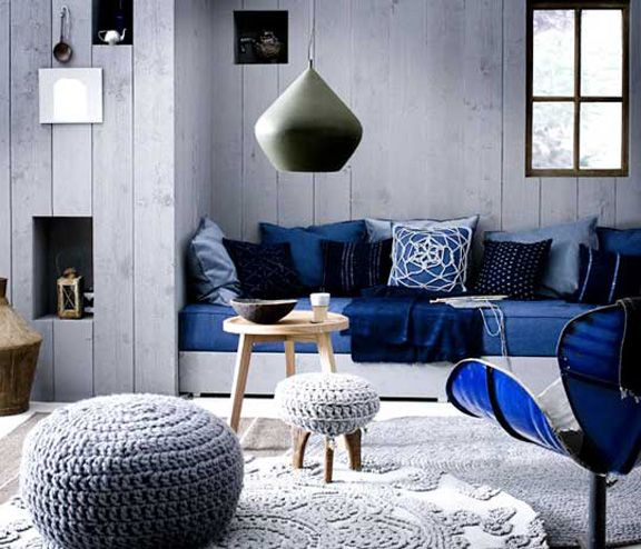 This room is monochromatic with its different blue hues. The shades and tints of blues give the cool room a feeling of relaxation and peace