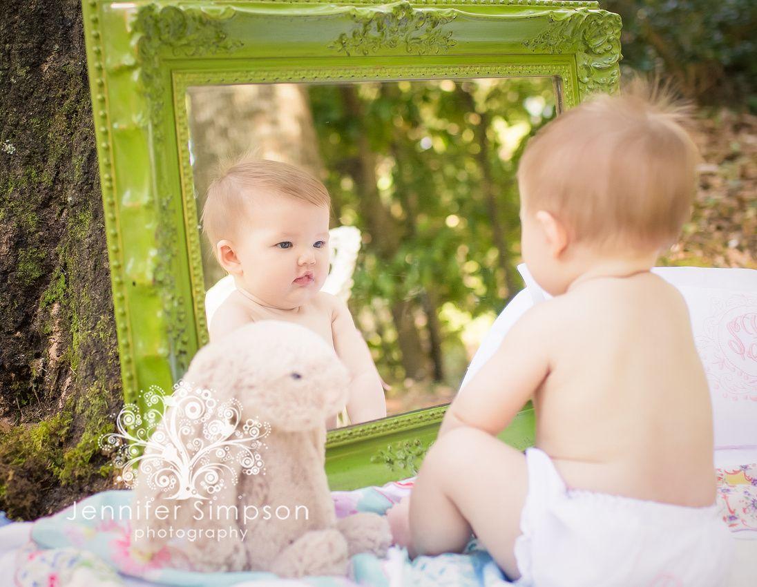 Baby girl in mirror with her favorite bunny. Baby girl photo shoot, baby photo Wilmington NC, www.jennifersimpsonphoto.com