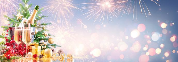 Photo of New Year Celebration With Champagne And Fireworks – Golden Lights On Blue Backgr…
