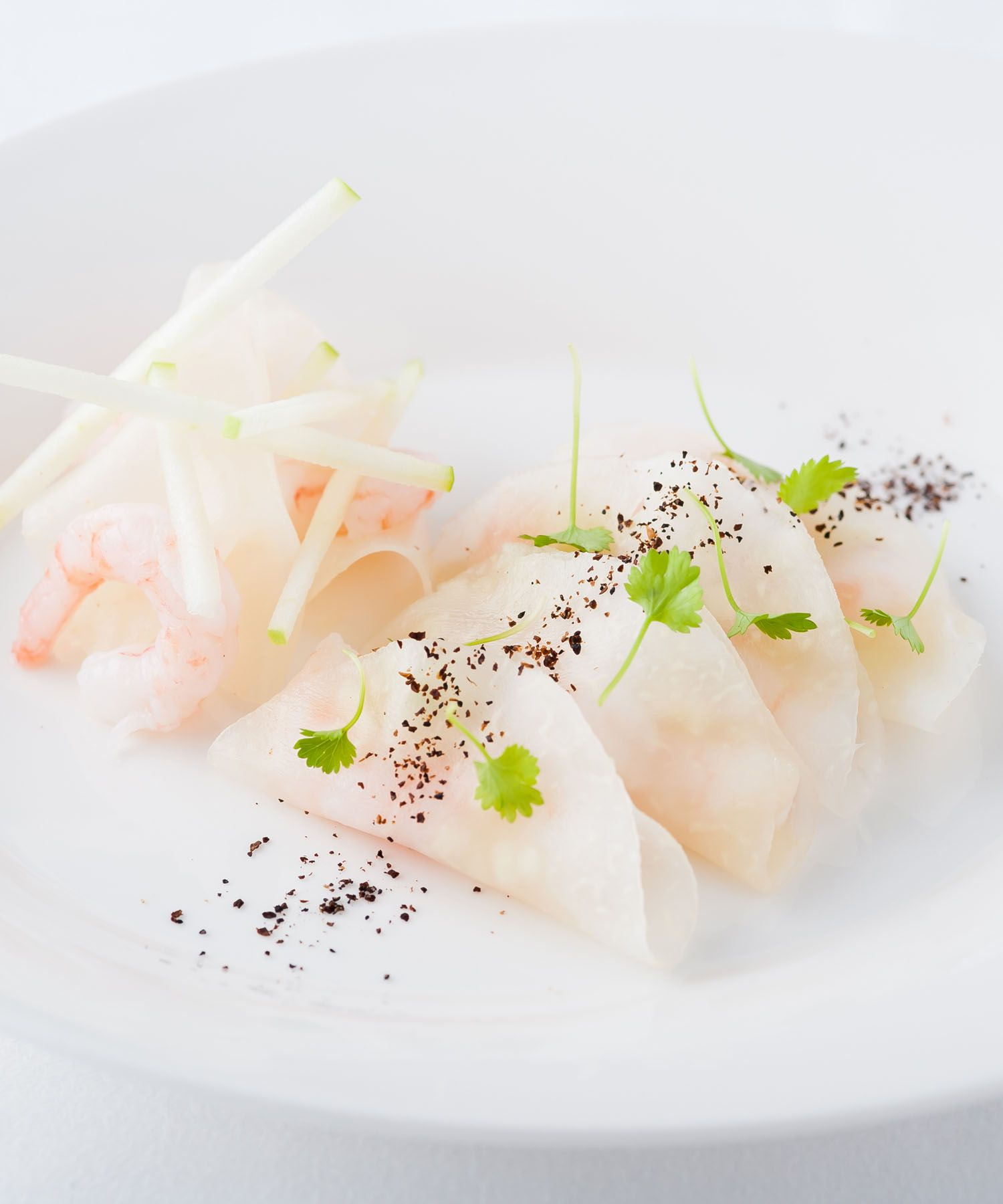 In this delicious prawn starter by Simon Hulstone, sliced kohlrabi is pickled in a vacuum bag to give the vegetable a soft, malleable texture. This process enables the kohlrabi slices to be used like tacos, which the chef fills with a delicately balanced combination of apple purée, lemon peel, prawn and Nepalese pepper. If available, Simon Hulstone recommends using Norwegian prawns, although king prawns will work just as well.