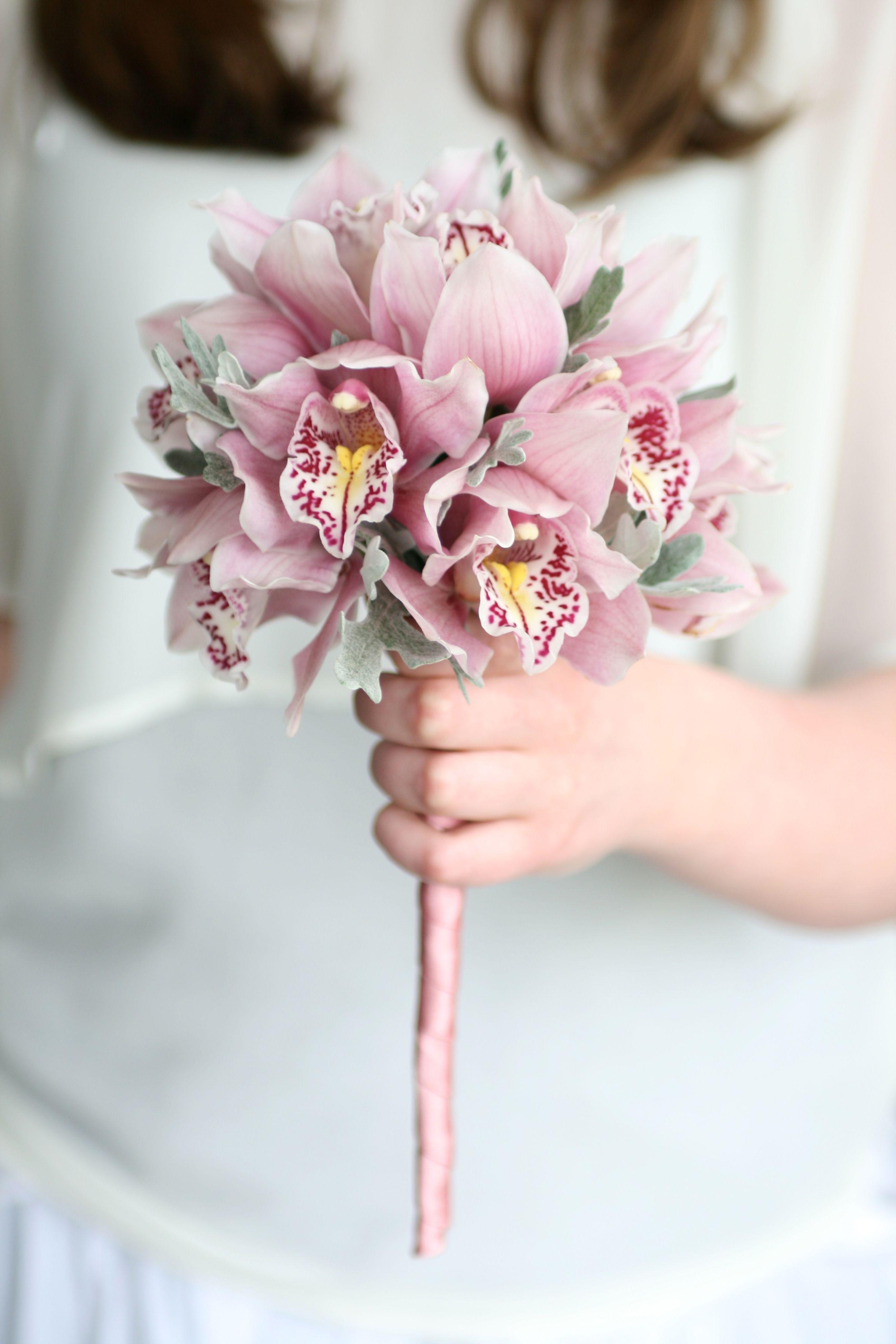 Flower girl wand of cymbidium orchids and senecio foliage. Liberty ...