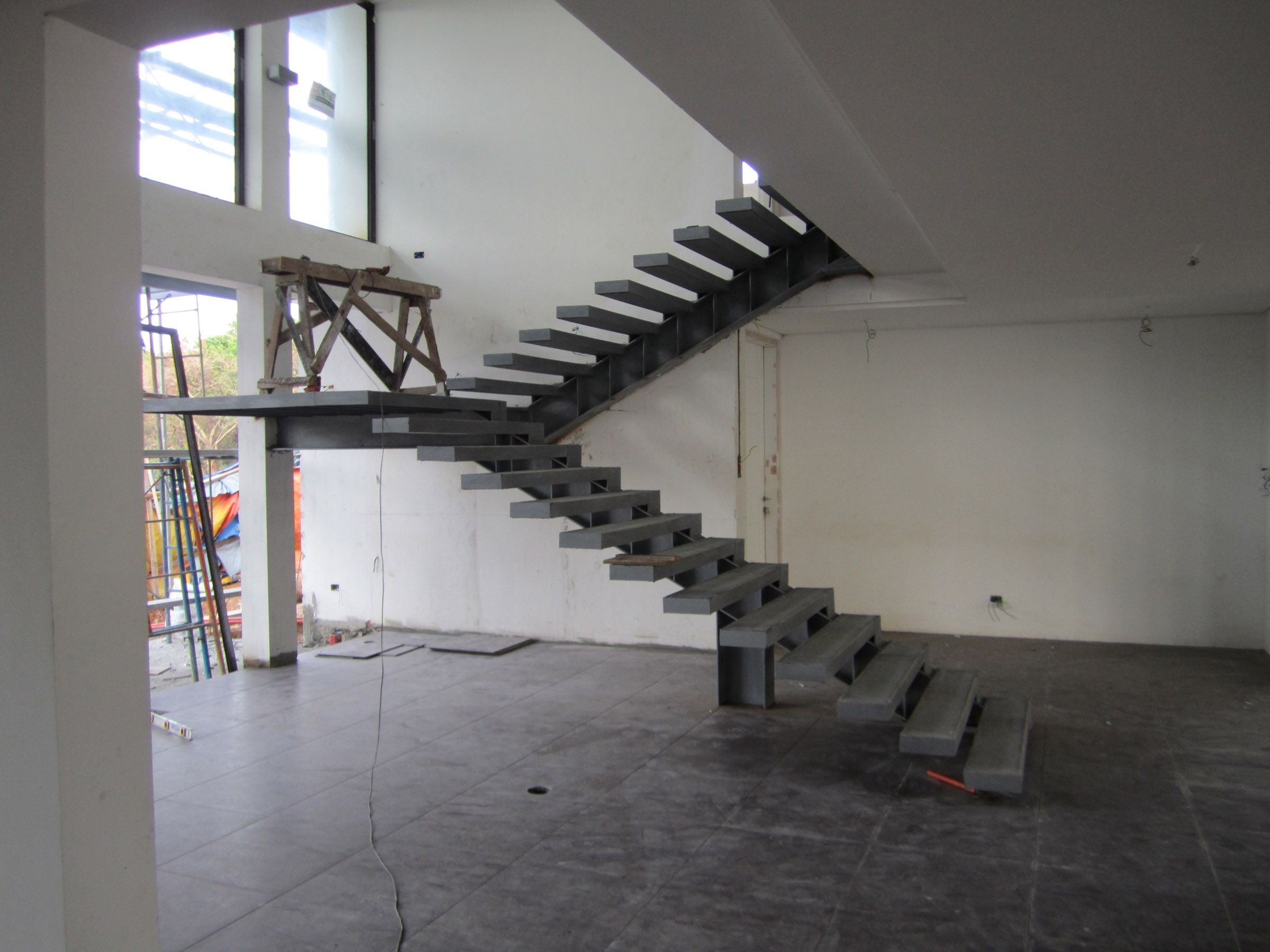 A Modern Cantilever Staircase In Steel And Wood.