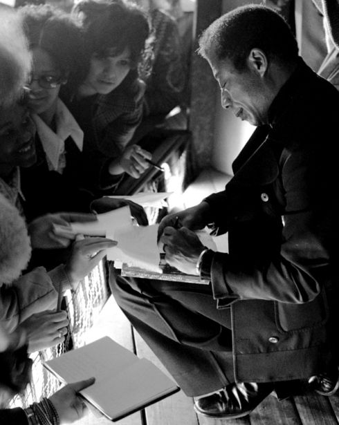 James Baldwin signing autographs for fans at Ludwigsburg High School in Germany, 1972.