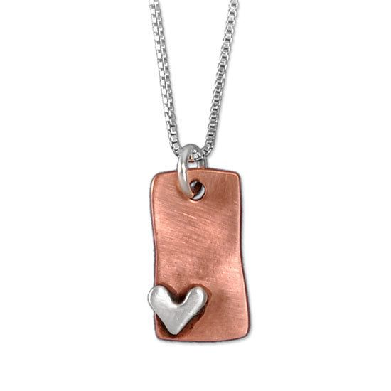 This warm, copper rectangle necklace is adorned with a fine silver heart and is hand-made in our California studio.  $49.00 (http://www.wholesouljewelry.com/subtle-devotion-copper-rectangle-necklace/)