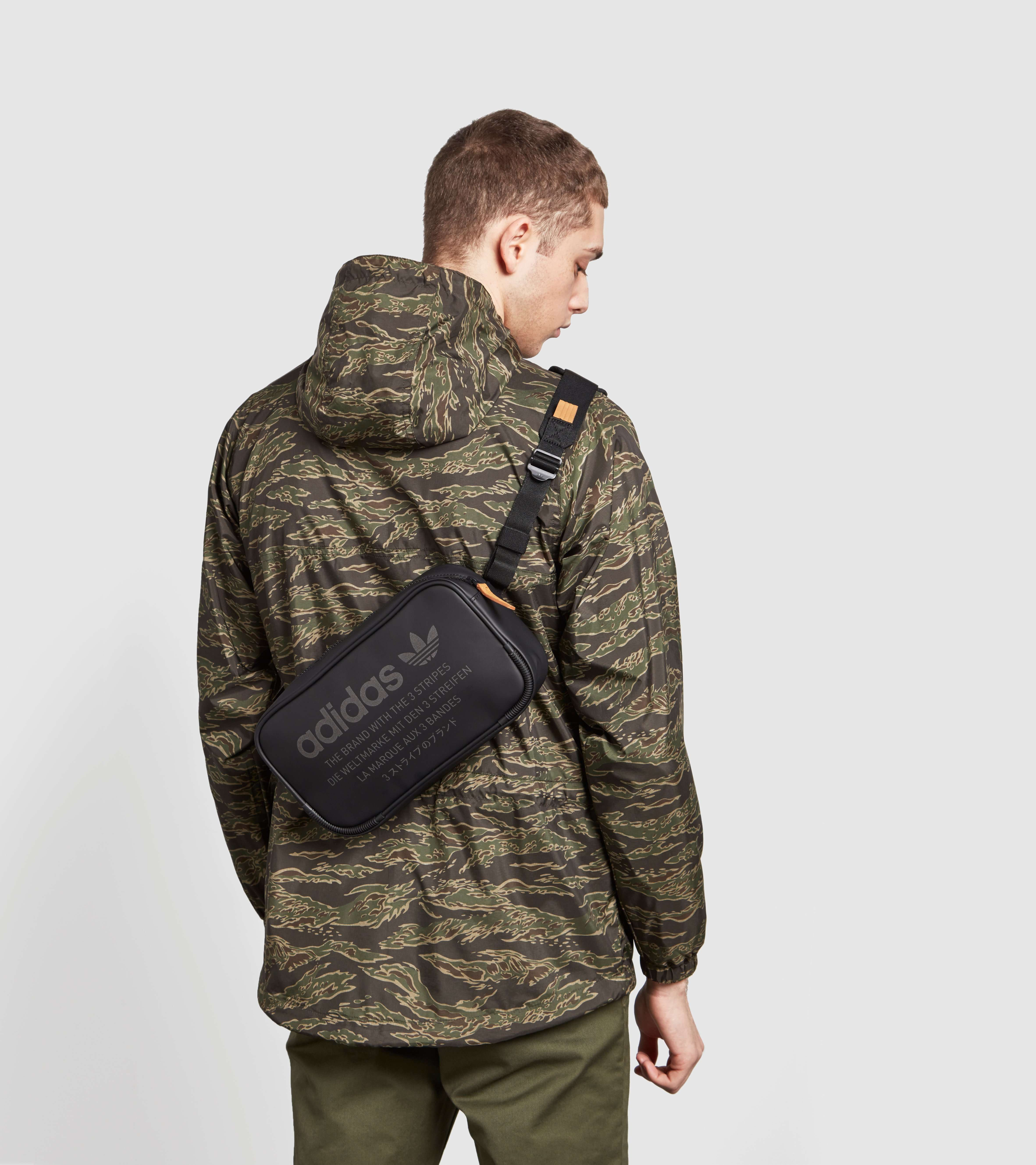 190722655bc adidas Originals NMD Side Bag - find out more on our site. Find the  freshest in trainers and clothing online now.