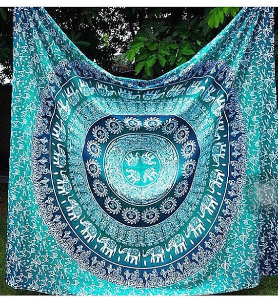 "Design: Mandala  Double size 90"" X 80"" Inches (approx)  P.S: We have mentioned the approx. Size but size may vary in length and width by 2 - 4 inches  Fabric: 100% Cotton Fabric, Screen Printed Design, Vegetable Colors.  Care: Dry Cleaning Or Cold Water Wash. Do not Tumble Dry.  Color:- blue green This gorgeous piece of art can be used as Bedspread, Bed Cover, Table Cloth, Curtain and of course as a Tapestry or a Wall Hanging.  This Tapestries are completely screen printed in traditional…"
