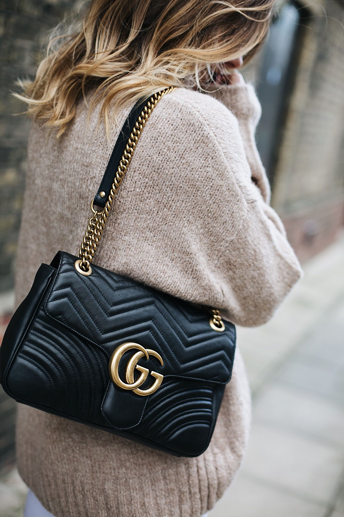 172e44d5e Beige chunky sweater, medium black leather Gucci Marmont Matelasse bag,  balayage hair