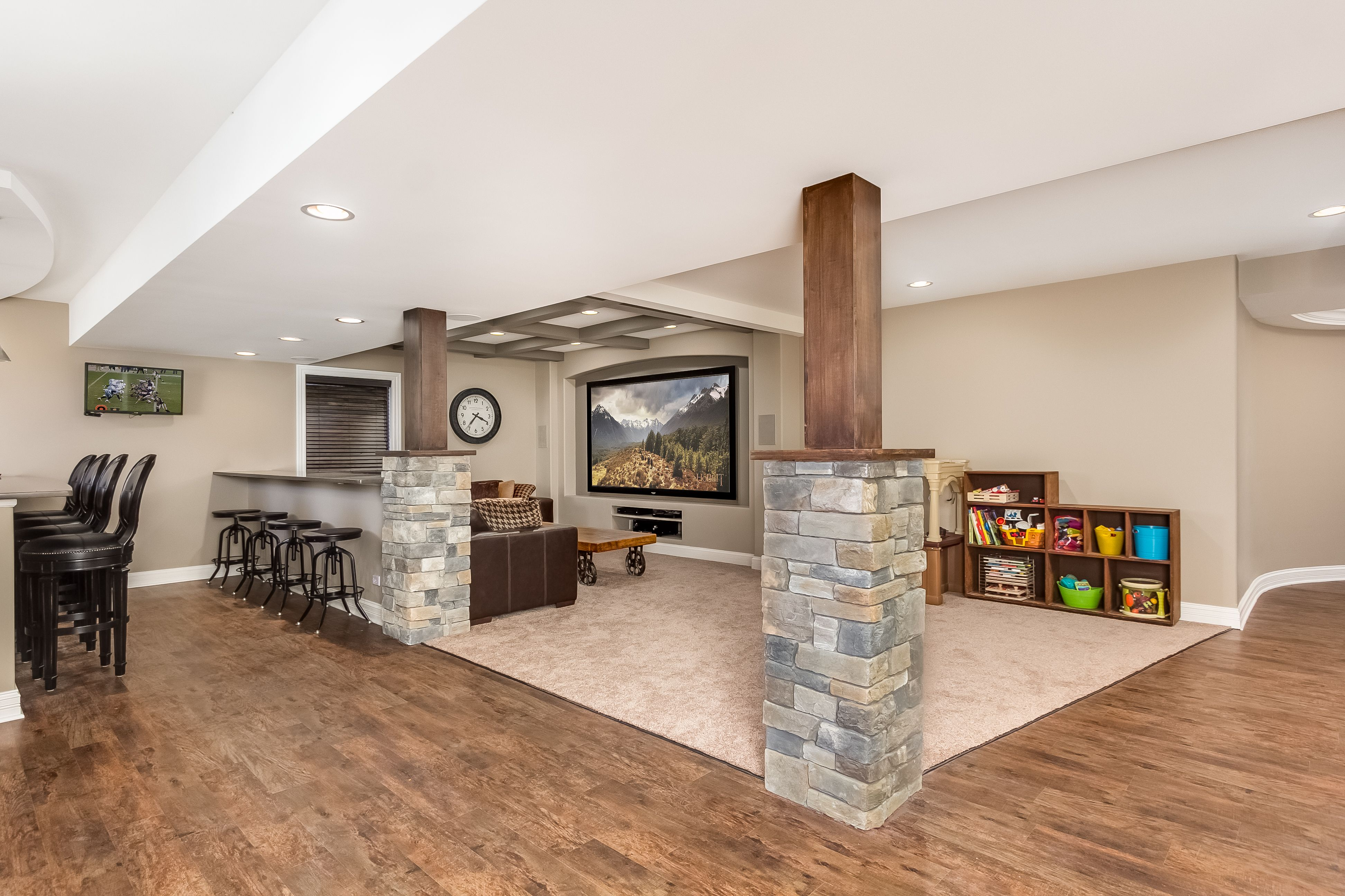 finished basement company theatre playroom and bar seating