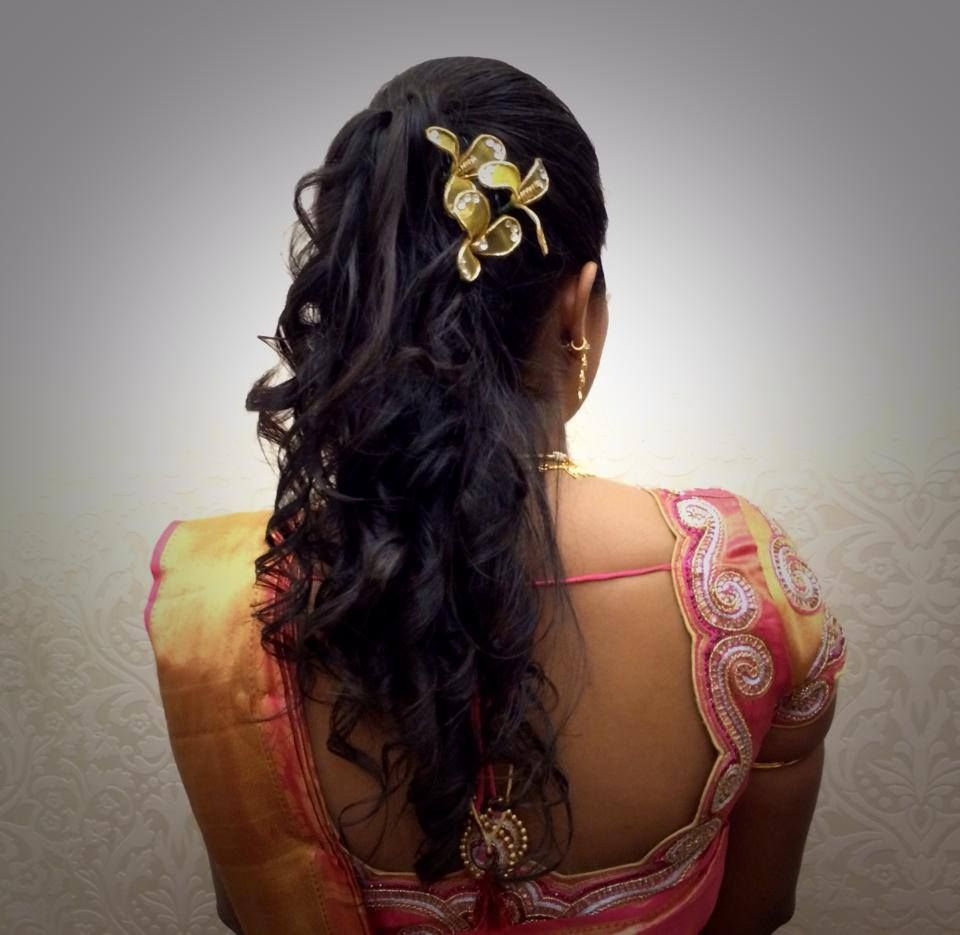 indian bride's bridal reception hairstyle by swank studio. find us