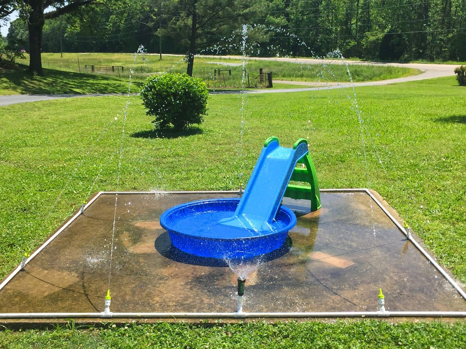 $40 DIY Splash Pad little white house blog Our DIY Splash Pad
