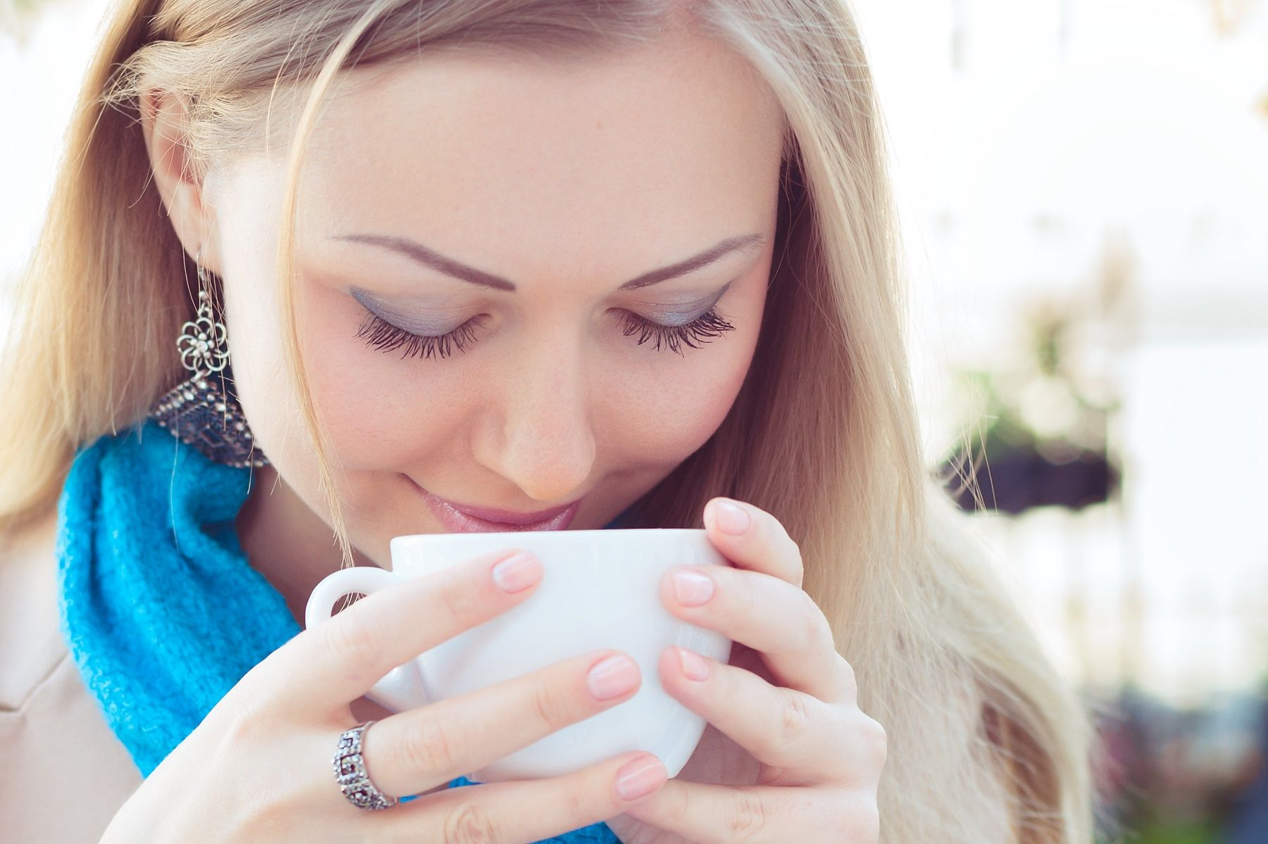 Woman smelling coffee - iStock/Getty Images