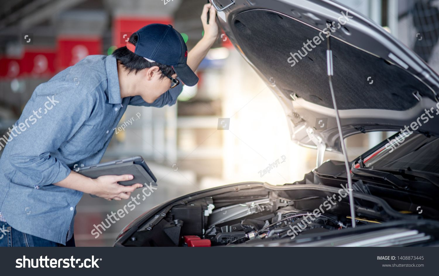 Asian Auto Mechanic Holding Digital Tablet Checking Car Engine Under The Hood In Auto Service Garage Mechanical M Car Repair Service Auto Service Car Mechanic
