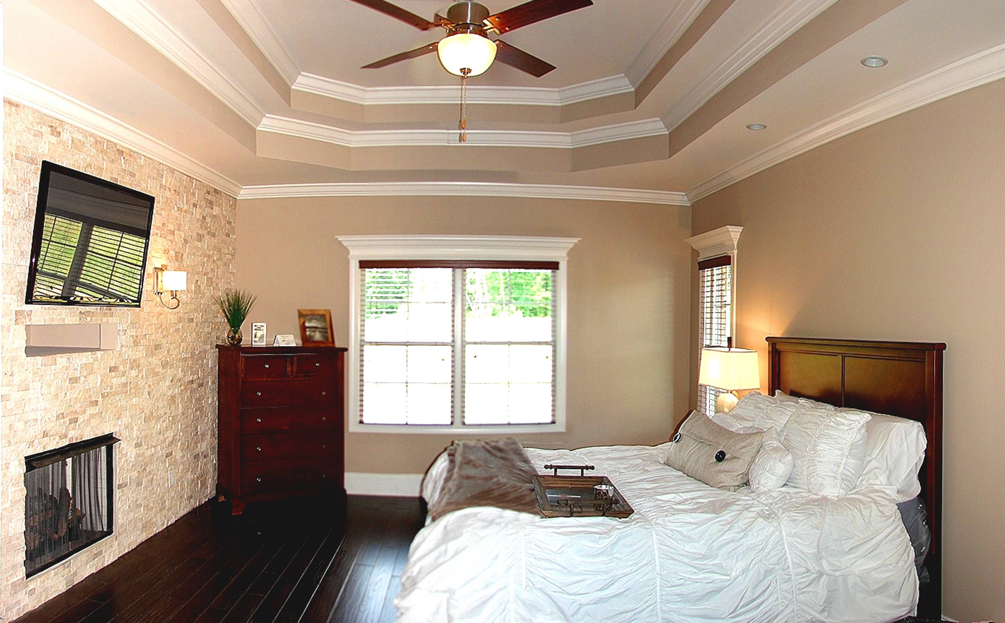 Master Bedroom Tray Ceiling this master bedroom features a stone accent wall with fireplace