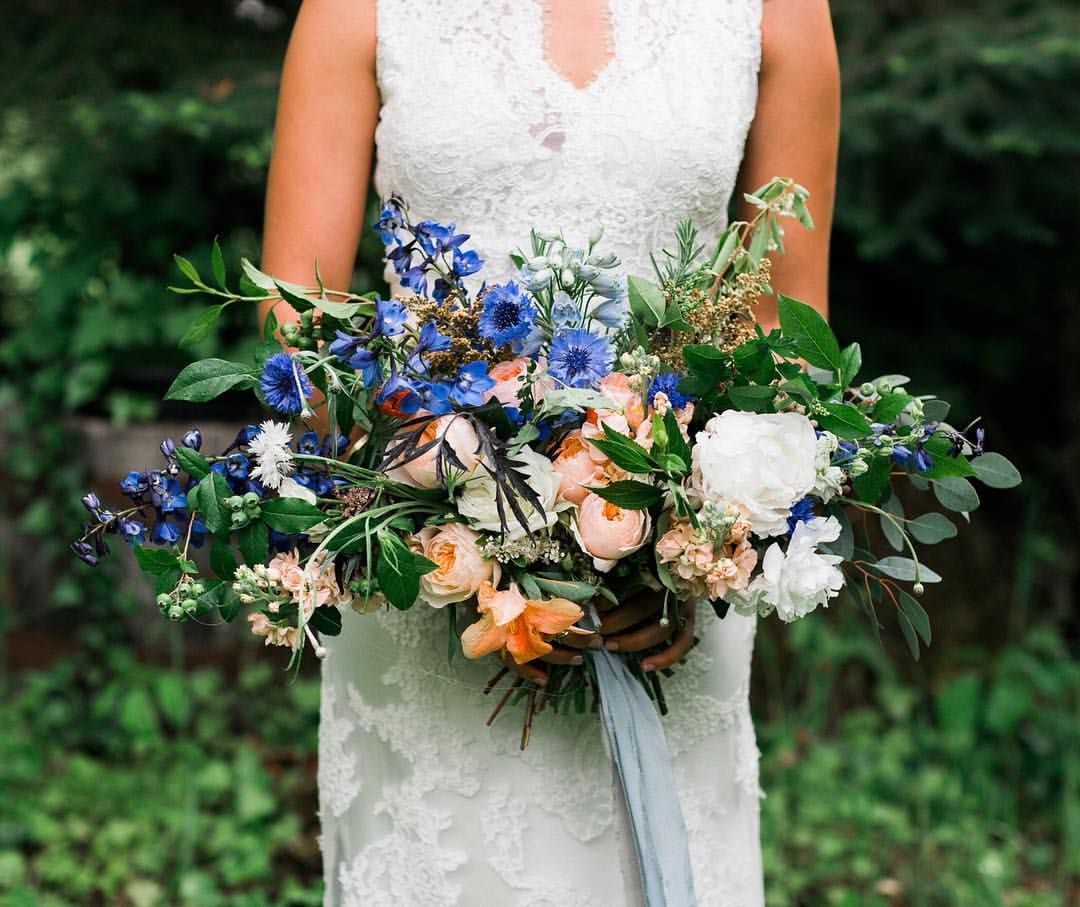 This gorgeous boho + wildflower bridal bouquet features a