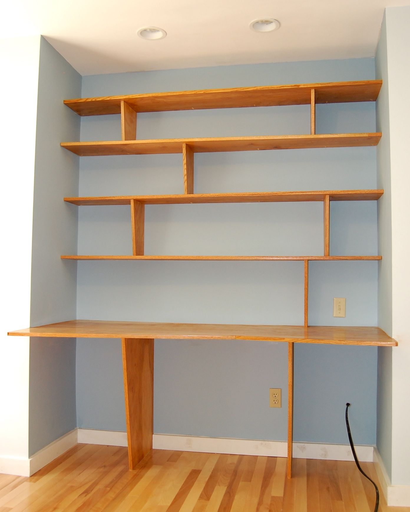Built In Wall Shelves One Leg Two Leg Desk And Shelves Desks Shelves And Blue Walls