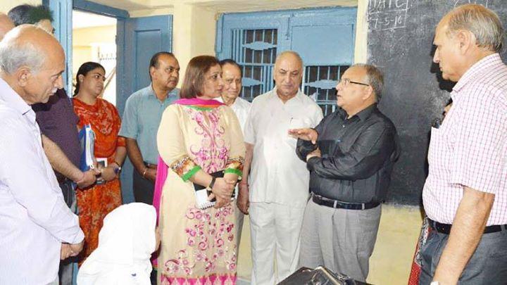 Chief Secretary B R Sharma interacting with staff of Educational-cum-Vocational School on Saturday.