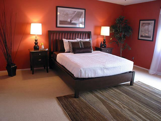You Will Smile Until You Realize You Had To Sell Or Stage A House Just Like This Orange Bedroom Walls Bedroom Orange Living Room Orange
