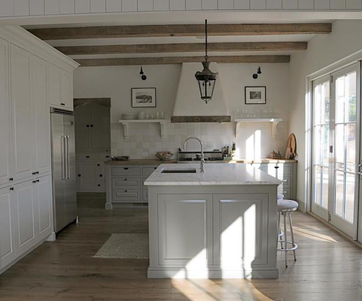 white and gray kitchen features rustic wood beams on ceiling accented with a glass and iron on kitchen interior grey wood id=28924