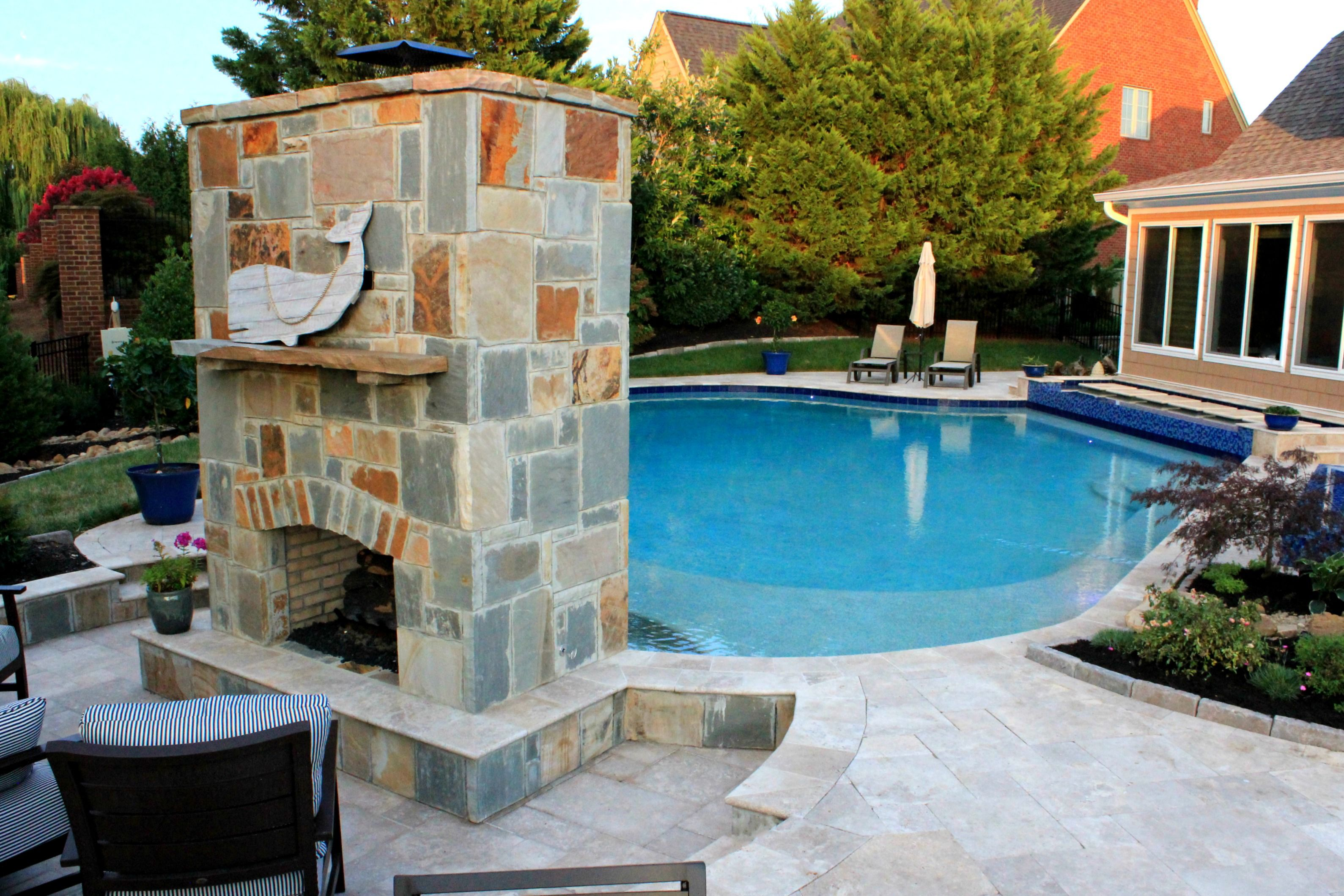 Sheer Wall Descent Features On A Gunite Concrete Pool, With