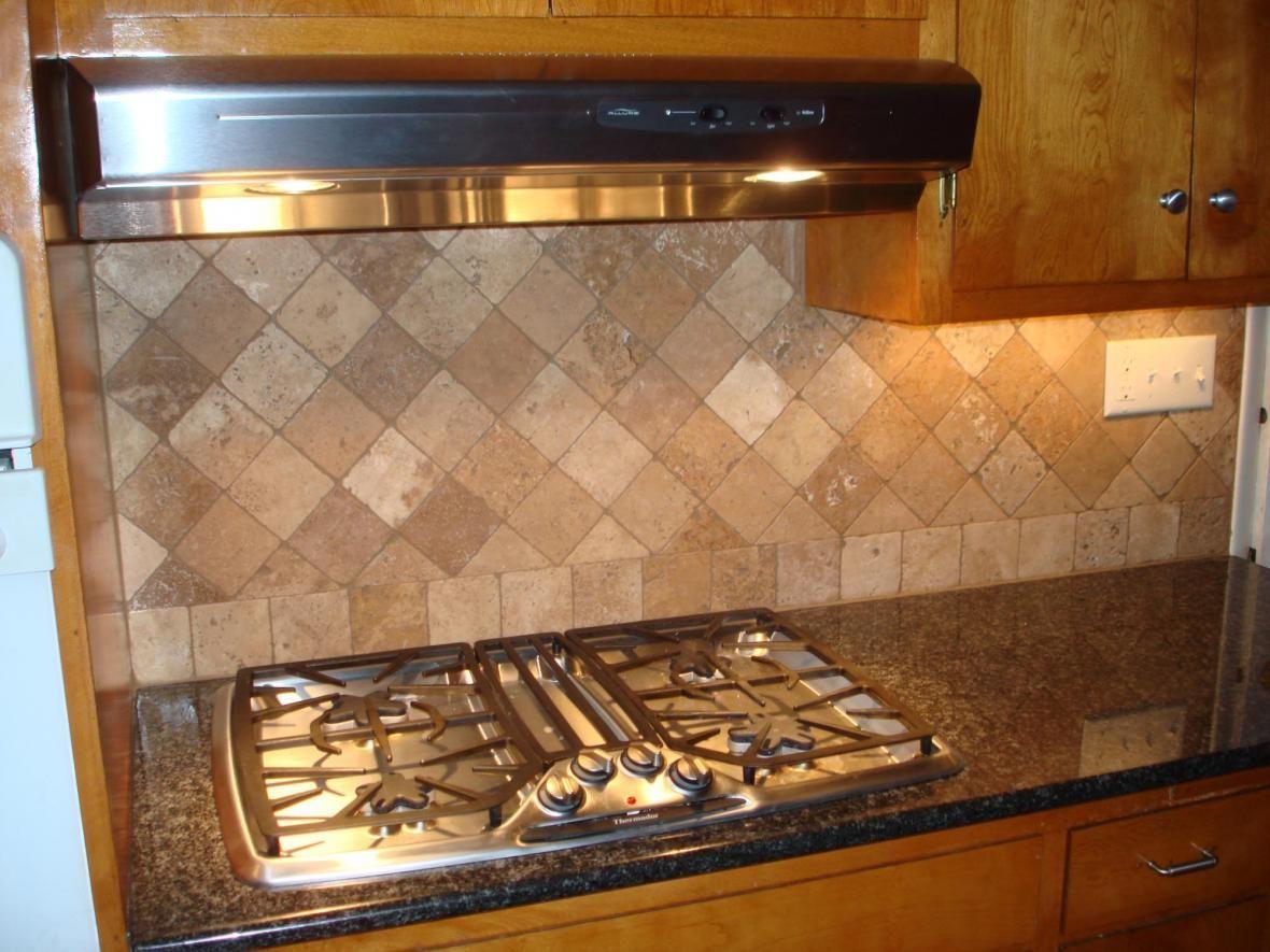 Diagonal stone back splash design behind kitchen stove top for Different backsplash behind stove