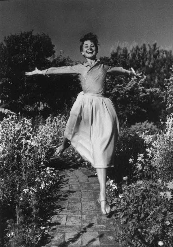 Audrey-shirt tucked into a full skirt. WHy not wear a