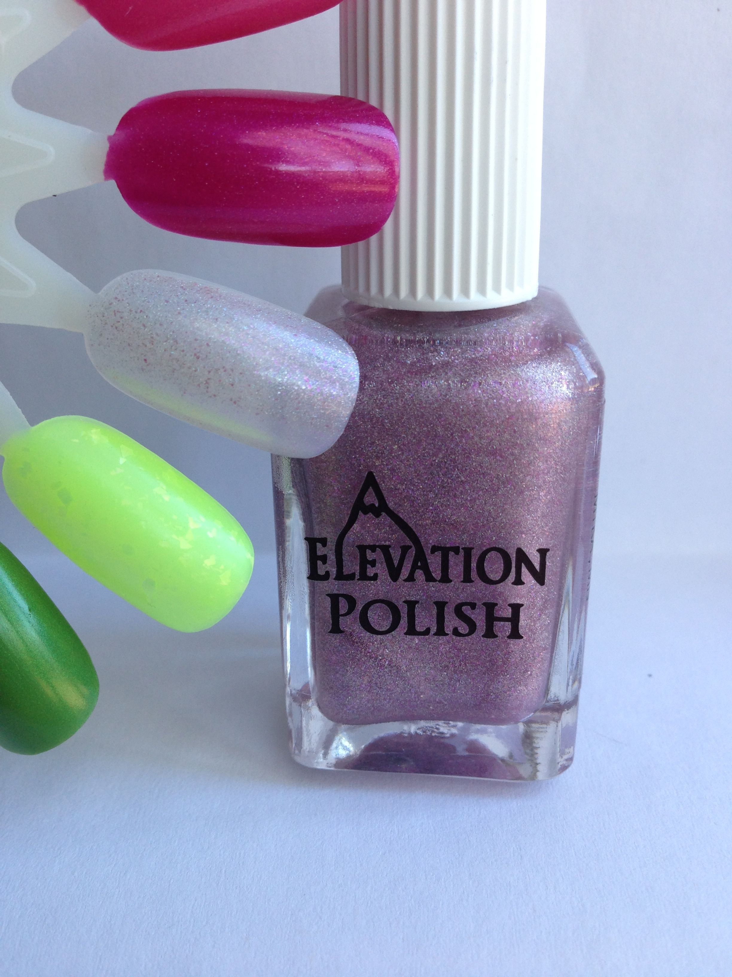 Name: Peruvian Twinkle  Description: Clear base with a scattering of pink flake shimmer, and holographic pigment