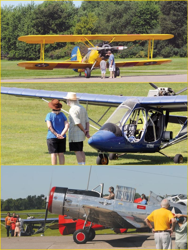 Visitors look over the vintage aircraft on display. The