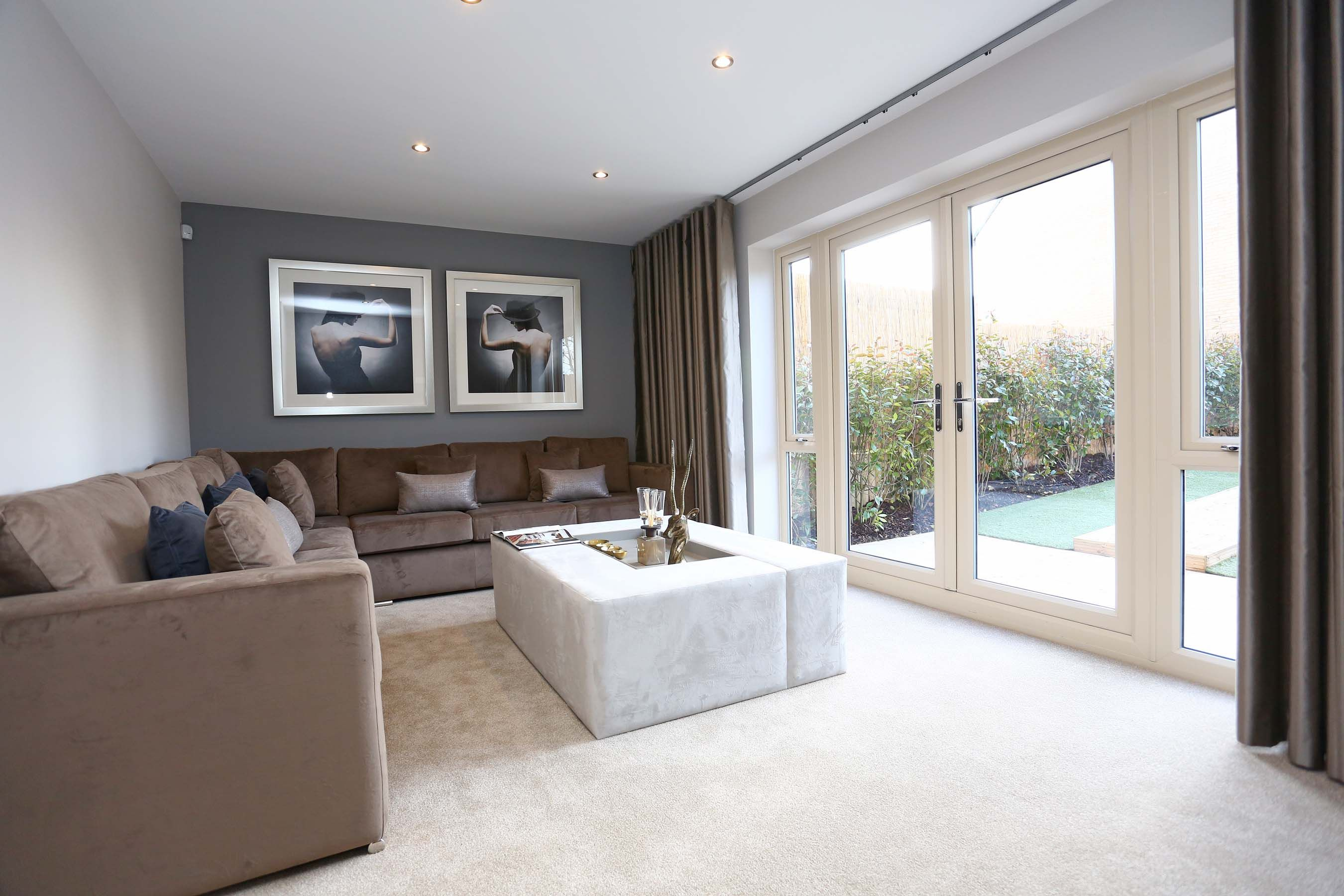 The Lounge Spans The Back Of The Home With Large French Doors That