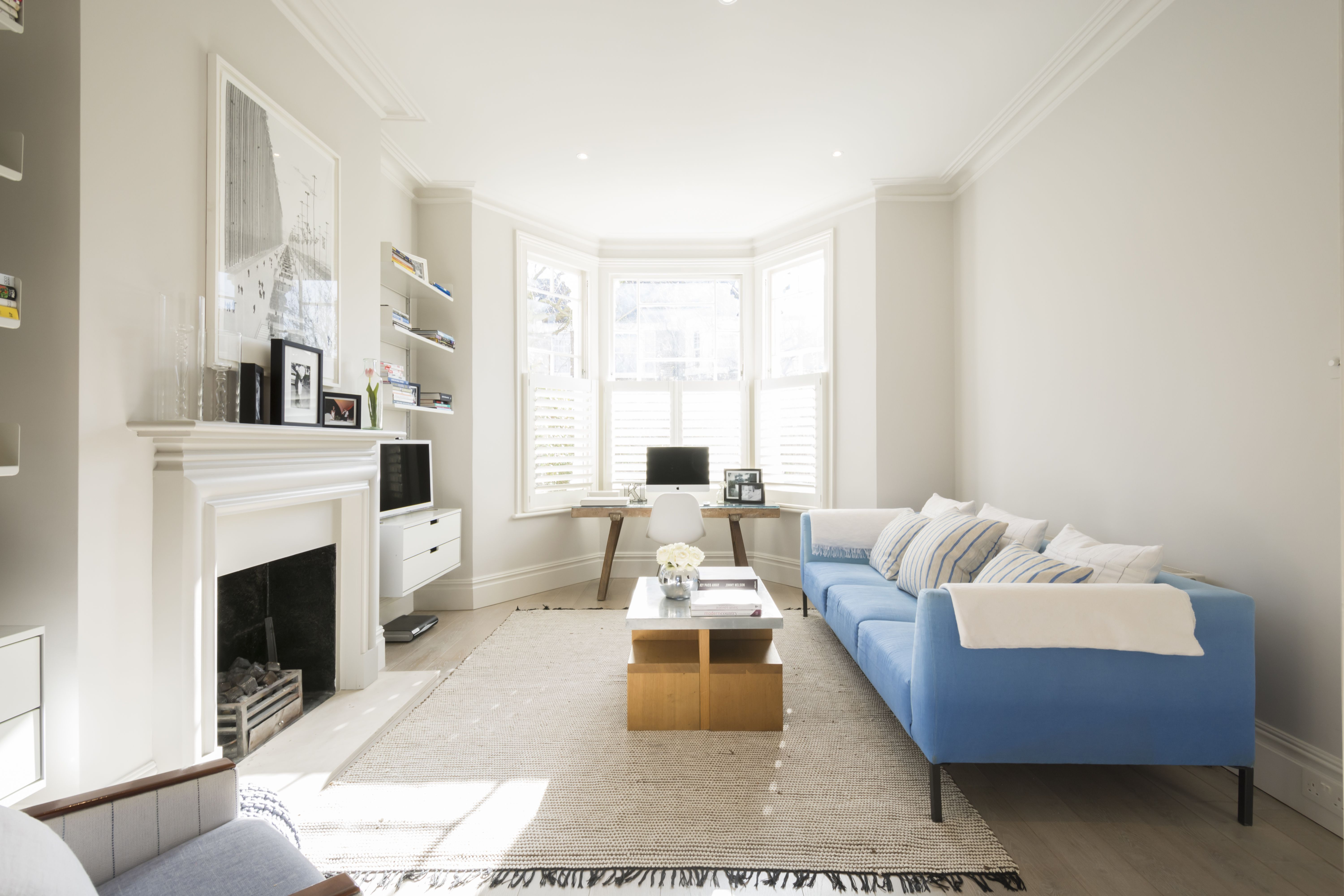 Living Room With Light Blue Sofa Fireplace And White Plantain Shutters In Victorian House Londo Interior Design Beautiful Living Rooms Interior Design Studio