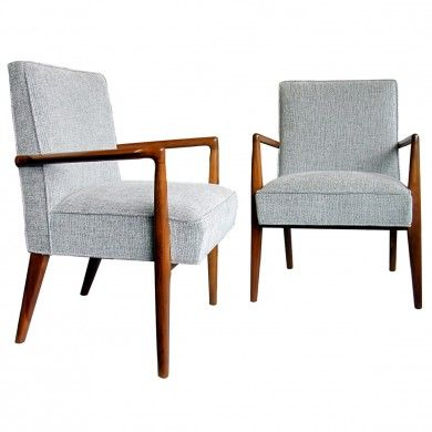 MID CENTURY ARM CHAIRS Pair of Mid Century arm chairs reupholstered in a grey tweed with walnut arms and legs. The arm rests flatten and get wider from the rounded and curved front leg.