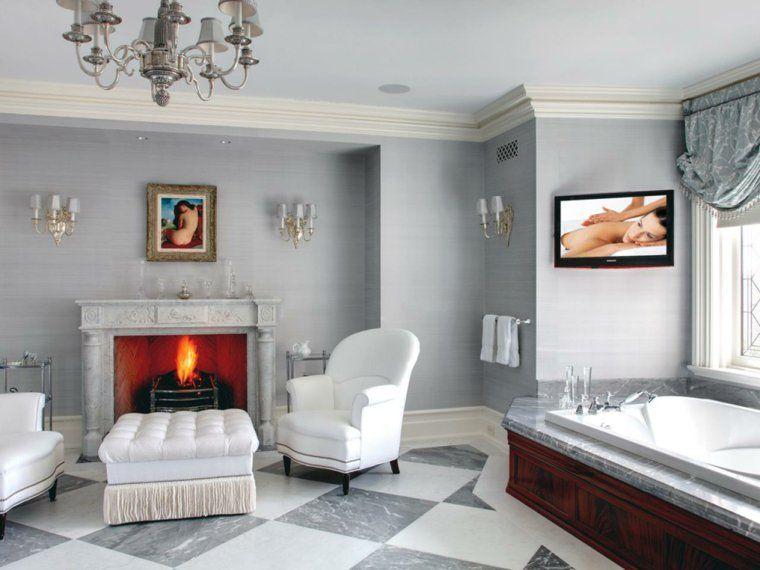 salon élégant moderne design fauteuil blanc pouf cheminée pierre blanche idée carrelage salon