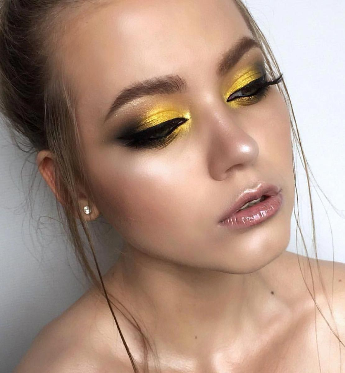 Yellow and black eyeshadow makeup Smokey eye look