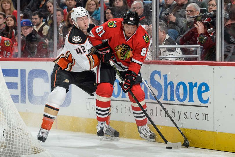: Josh Manson #42 of the Anaheim Ducks and Marian Hossa #81 of the Chicago Blackhawks chase the puck in the first period of the NHL game at the United Center on February 13, 2016 in Chicago