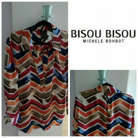 BISOU BISOU MASONIQUE STRIPED PRINTED LOOKING AS RAPPER AND SANDY AS YOU DO IN THIS MASONIQUE STRIPED PRINTED BLOUSE. THIS BREEZE MASONIQUE STRIPED PRINT OXFORD TELLS EVERYONE YOU'VE GOT SOMEWHERE FAB TO GO, AND YOU'LL ARRIVE IN STYLE.  *100% POLYESTER  *MACHINE WASH COLD *MADE IN INDONESIA  *LONG SLEEVES WITH BOTTOMS Bisou Bisou Tops Blouses