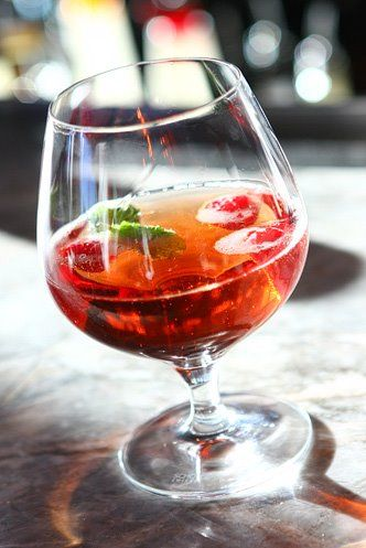 A French classic with a #Vegas twist.....the Kir Royal as prepared at the Eiffel  Tower Restaurant at Paris Las Vegas Hotel    1.5 oz raspberry liqueur  6 oz champagne  1 sprig of mint fresh raspberries    Mix ingredients and serve in a snifter