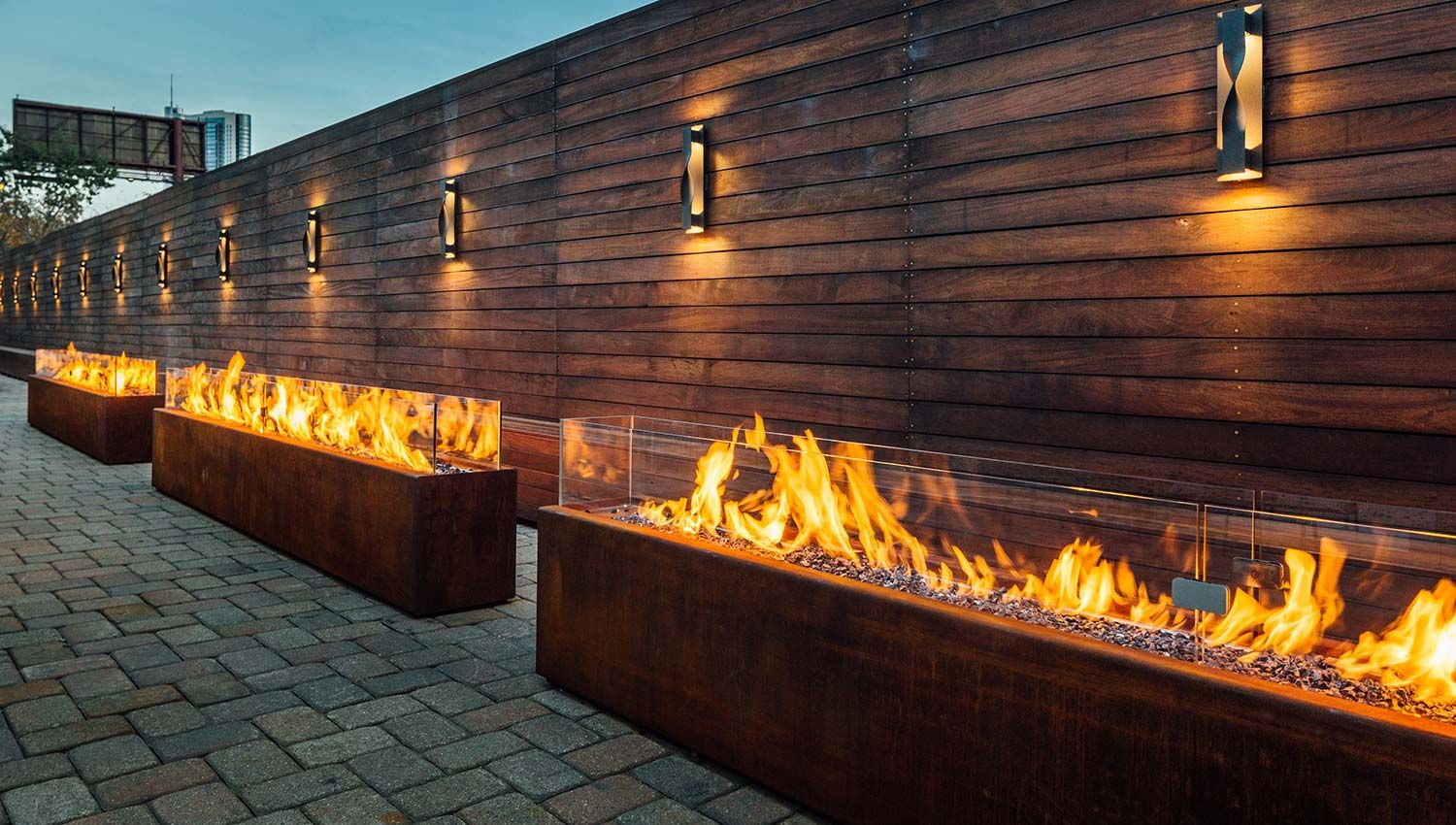 Komodo Outdoor Linear Fire Pit | CSA CE Certified | Paloform North America  UK Europe | Custom models shown in Corten steel with lava rock topping and  glass ... - Komodo Outdoor Linear Fire Pit CSA CE Certified Paloform North