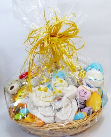 A Cute Baby Shower Gift Basket With A White Dotted Cellophane Gift